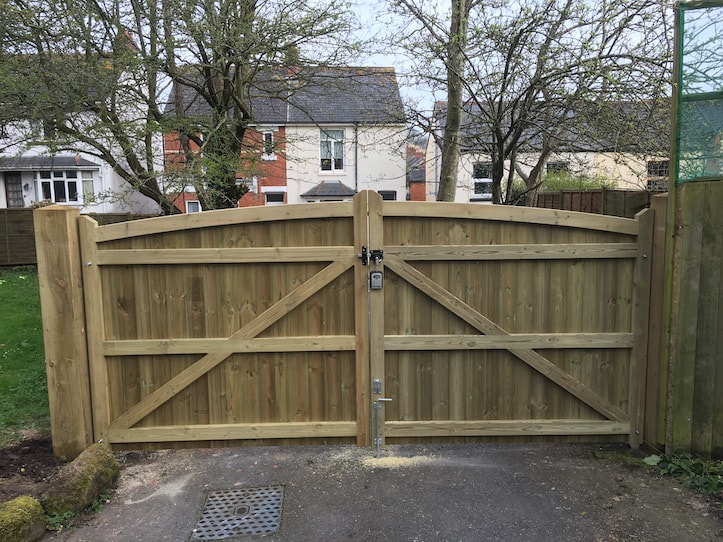 double gate on driveway with curved top